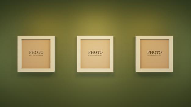 Quadros de maquete moderna na parede verde.