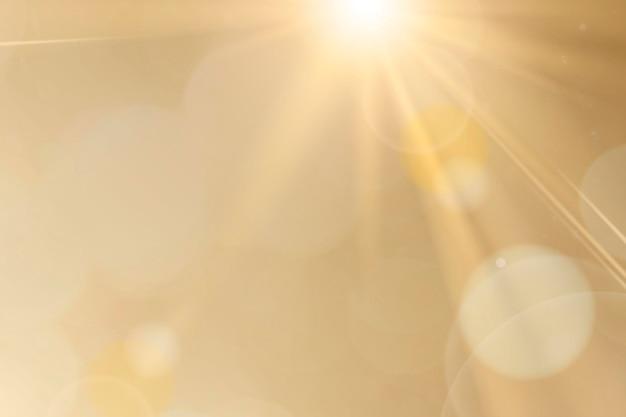 Reflexo de lente de luz natural psd em efeito de raio de sol de fundo dourado