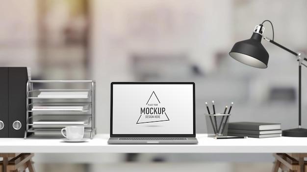Renderização 3d, mesa de escritório com laptop, artigos de papelaria, lâmpada e material de escritório em desfocado