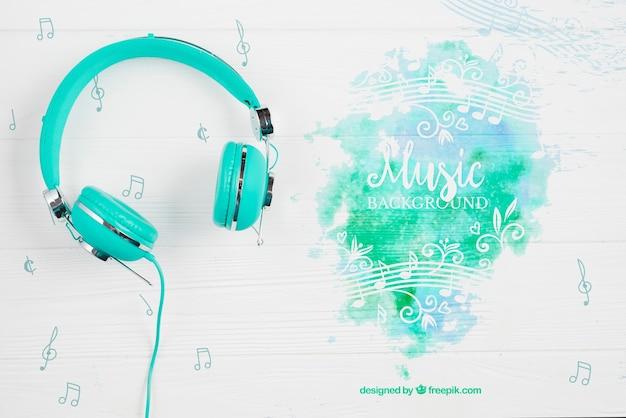 Respingo de tinta de música com fones de ouvido ao lado