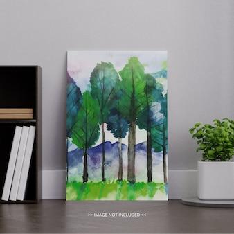 Retrato em branco branco lona quadro maquete no quarto com plantinha