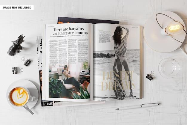 Revista aberta na maquete da mesa