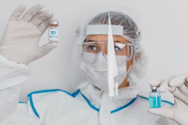 Roupa médica e maquete de vacina