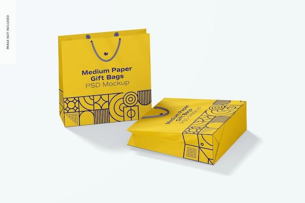 Saco de presente médio de papel com maquete de alça de corda, caído