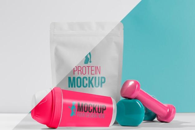 Saco de proteína em pó e pesos