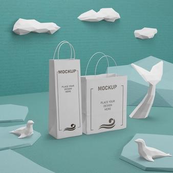 Sacos de papel do dia do oceano com maquete