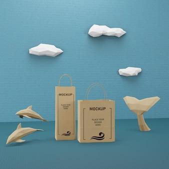 Sacos de papel e conceito de vida marinha com maquete
