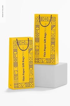 Sacos de presente de papel fino com maquete de alça de corda, vista frontal
