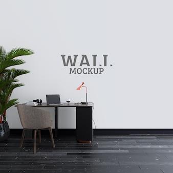 Sala de escritório com mesa de trabalho e maquete de parede