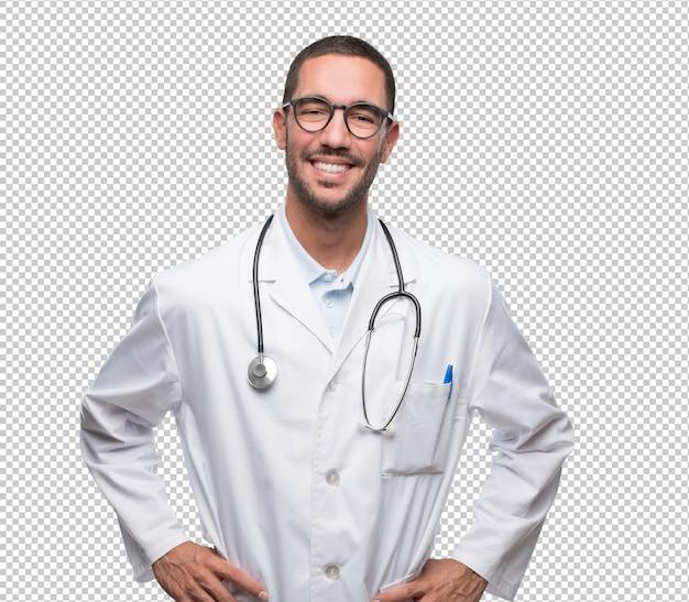Satisfeito jovem médico posando Psd Premium