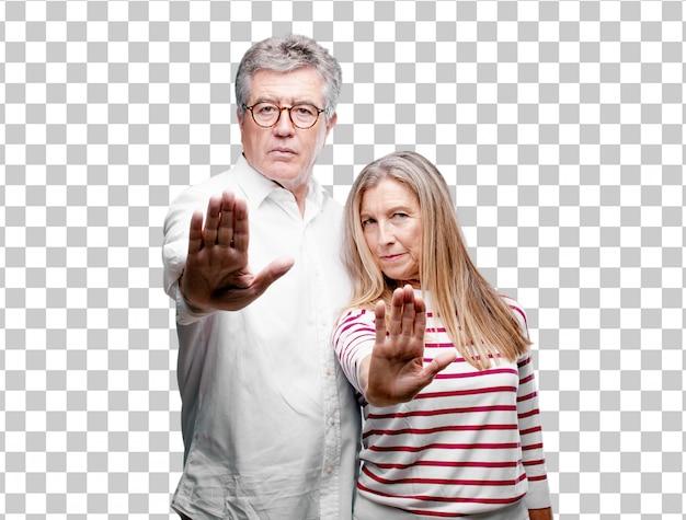 Senior legal marido e mulher sinalização parar com a palma da mão