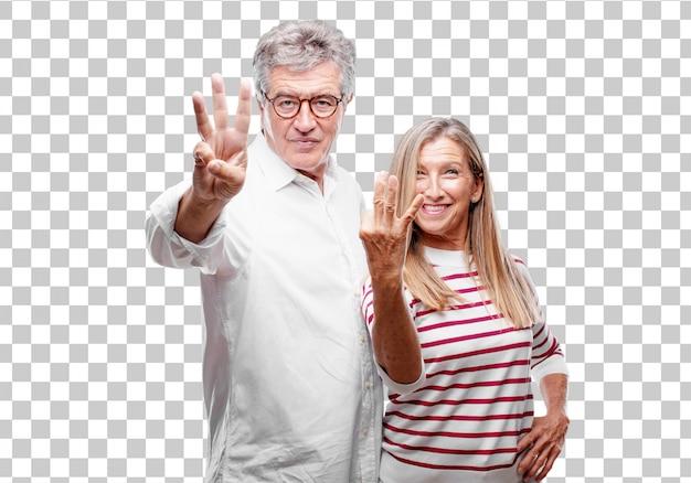 Senior legal marido e mulher sorrindo e olhando satisfeito e feliz, contando o número thre