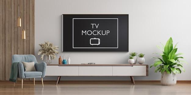 Smart tv na parede branca da sala de estar com poltrona renderização em 3d