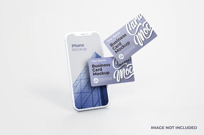 Smartphone branco com maquete de cartão de visita