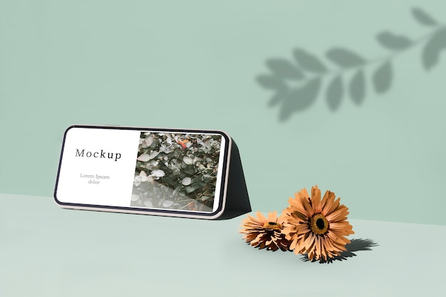 Smartphone com sombra e flores