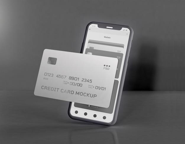Smartphone e maquete de cartão de crédito
