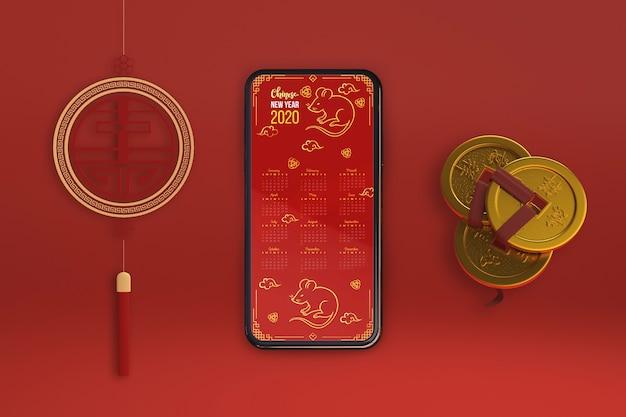 Smartphone e ornamentos para o ano novo