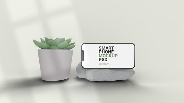 Smartphone horizontal em maquete de mármore