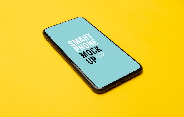 Smartphone preto com tela e fones de ouvido sem fio