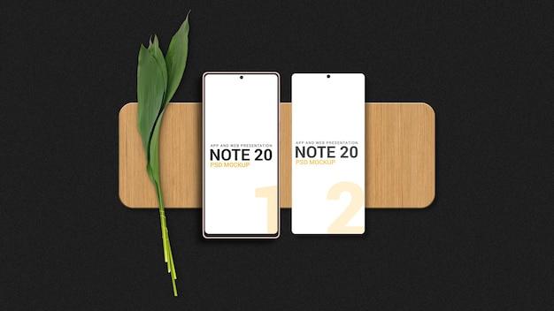 Smartphones em maquete de tábua de madeira