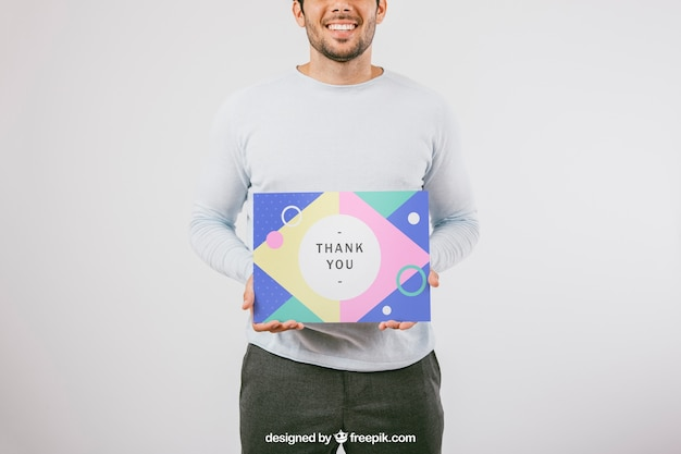 Smiley man holding poster mock up