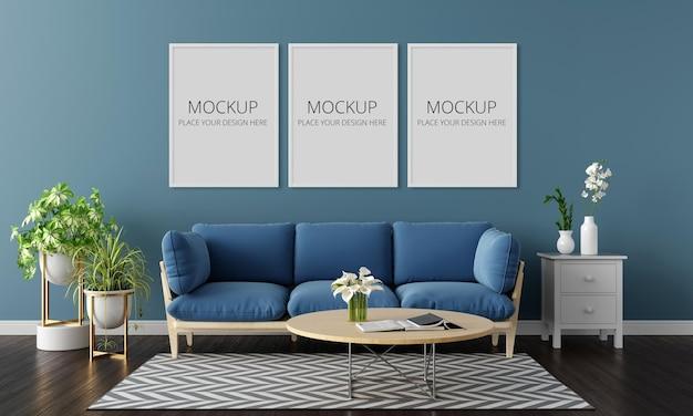 Sofá azul no interior da sala de estar com maquete de três quadros