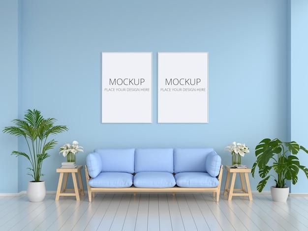 Sofá e planta na sala de estar azul com maquete de quadros