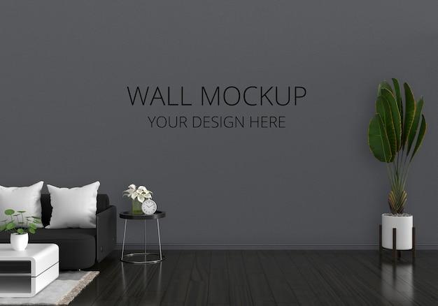 Sofá preto no interior da sala de estar com maquete de parede