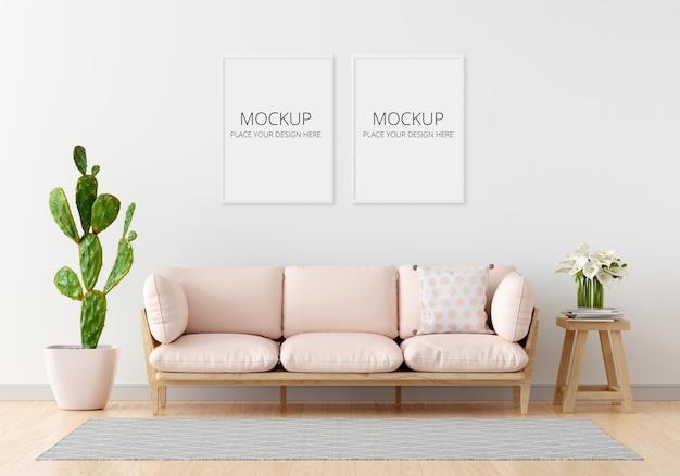 Sofá rosa na sala de estar branca com maquete de moldura