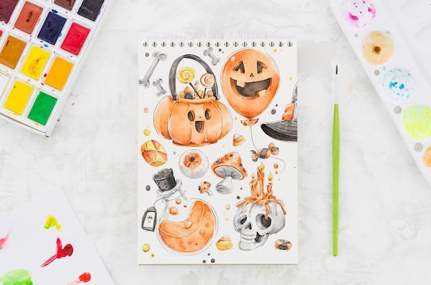 Sorteio artístico de halloween no notebook