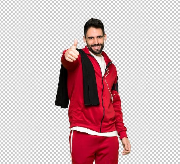 Sportman bonito dando um polegar para cima gesto porque algo bom aconteceu
