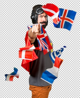 Super-herói com um monte de bandeiras apontando para a frente