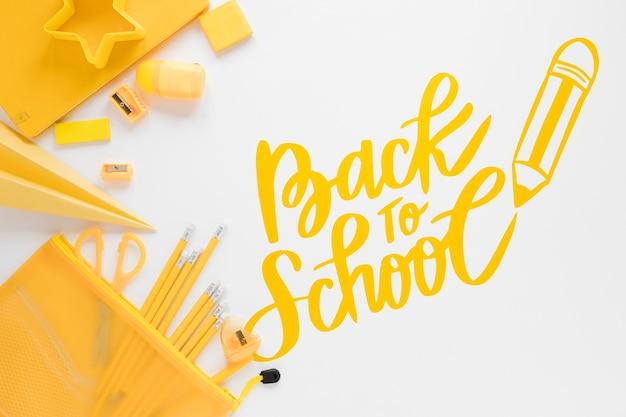 Suprimentos amarelos para voltar ao evento escolar