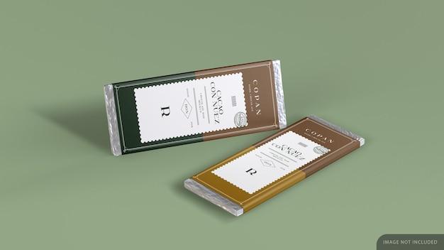 Tablet de duas barras de chocolate com desenho de maquete de papel de embrulho em renderização 3d