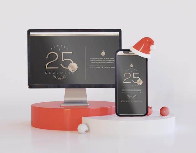Tela de computador e maquete de smartphone com decoração de natal
