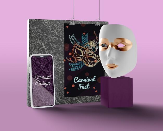 Telefone com design de carnaval ao lado da máscara