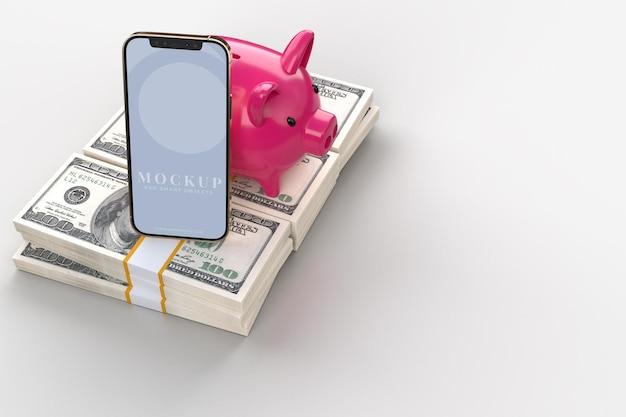 Telefone inteligente e cofrinho rosa com dinheiro