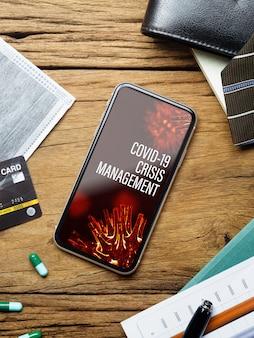Telefone móvel de maquete para o conceito de gerenciamento de crise de negócios covid19