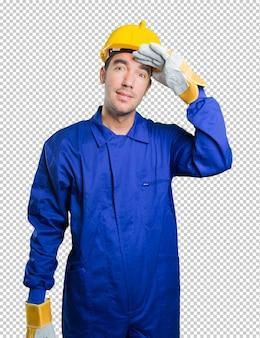 Trabalhador atônito com gesto de busca no fundo branco