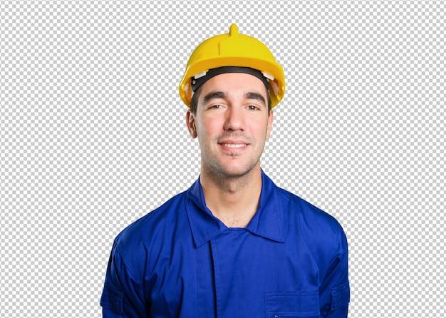 Trabalhador feliz posando em fundo branco