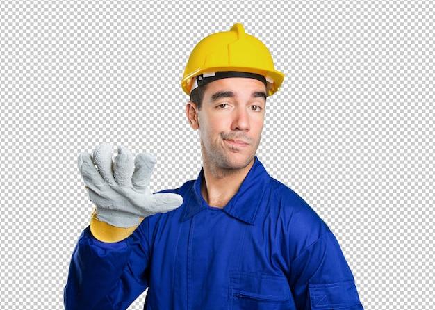 Trabalhador sério com mantenha o gesto calmo no fundo branco