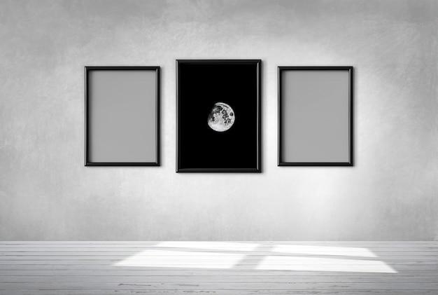 Três quadros em uma parede