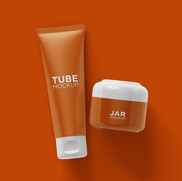 Tubo cosmético de vista superior e maquete de frasco isolados