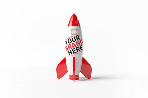 Uma maquete de um foguete vermelho sobre branco