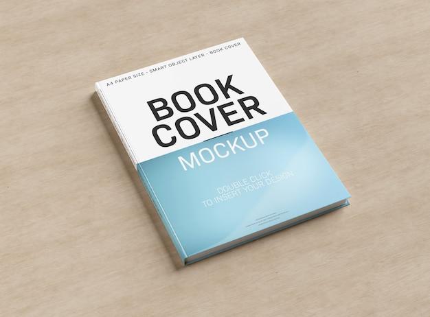 Uma maquete de uma capa de livro na superfície de madeira