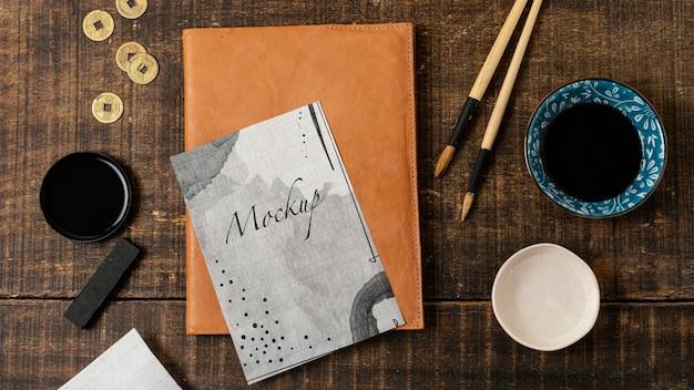 Variedade de elementos de tinta chinesa com maquete de papel