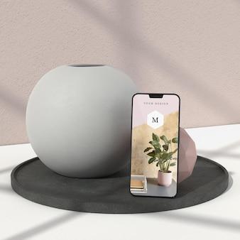 Vaso mínimo e maquete de telefone