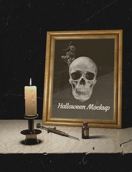Velas e quadro de mock-up de halloween com caveira