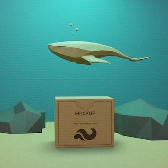 Vida marinha e caixa de papel com conceito de mock-up
