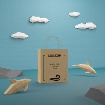 Vida marinha e conceito de saco de papel com maquete